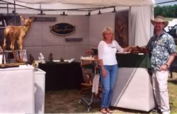 Roger and Vicki Smith in front of display booth at the Michigan Magazine Art Show.